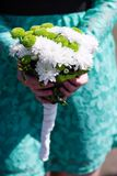 Bridesmaid holding a wedding bouquet Stock Image