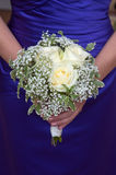Bridesmaid holding a wedding bouquet Royalty Free Stock Photos
