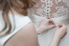 Bridesmaid lacing corset of wedding gown Stock Photo