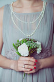 Bridesmaid with little flower bouquet Stock Photo