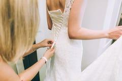 Bridesmaid makes bow-knot Royalty Free Stock Photo