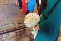 Bridesmaid with Orchid Bouquet Stock Image