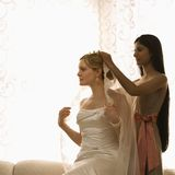 Bridesmaid placing veil. stock photography