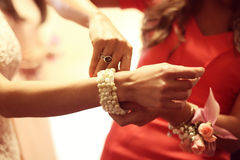Bridesmaid putting bracelet on bride Royalty Free Stock Photo