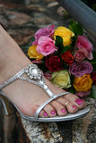 Bridesmaid's Shoe. A bridesmaid's shoe and bouquet on a stone wall Royalty Free Stock Photography