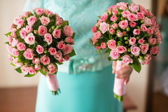 Bridesmaid shows bouquets Stock Images