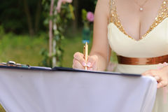 Bridesmaid Signing Certificate Royalty Free Stock Image