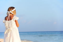 Bridesmaid Standing On Beach At Wedding Ceremony Royalty Free Stock Photo