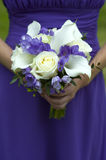 Bridesmaid with wedding bouquet Stock Images