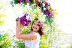 Bridesmaid with a wedding bouquet. Arch for weddin Stock Photos
