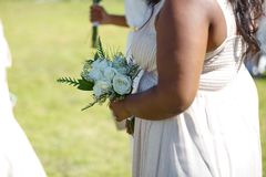 Bridesmaid with white roses stock photos