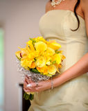 Bridesmaid with yellow roses Stock Images