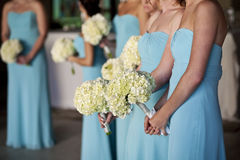 Bridesmaids. Horizontal image of bridesmaids holding their bouquets stock photography