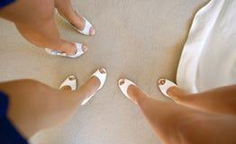 Bridesmaids. Beautiful legs of bridesmaids.Top view stock images