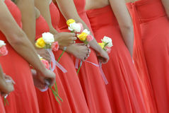 Bridesmaids. Holding flowers royalty free stock image