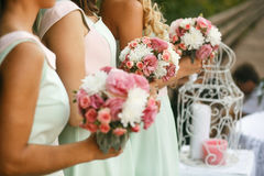 Bridesmaids admiring of bride. Bridesmaids admiring of girls with roses royalty free stock image