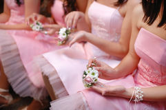 Bridesmaids With Bouquets. Row of bridesmaids with bouquets at wedding ceremony stock photo