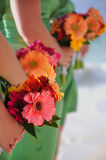 Bridesmaids bouquets. Closeup view of a row of floral bouquets held in the hands of bridesmaids at a beach wedding royalty free stock photos