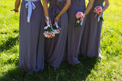 Bridesmaids. Bridal wedding flowers and brides closeup Stock Photo