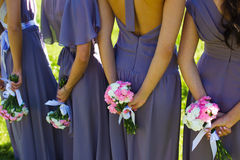 Bridesmaids. Bridal wedding flowers and brides closeup Stock Photography