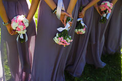 Bridesmaids. Bridal wedding flowers and brides closeup Royalty Free Stock Image
