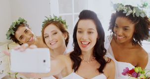 Bridesmaids and bride making pout while taking a selfie4K 4k
