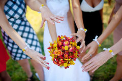 Bridesmaids are drawn to flowers. Hand bridesmaids are drawn to flowers Royalty Free Stock Photography