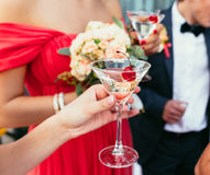 Bridesmaids Drinking martini cocktails with red cherry on the we Royalty Free Stock Images