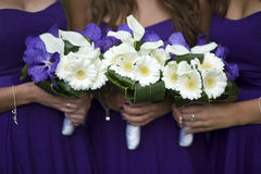 Bridesmaids with flower bouquets Royalty Free Stock Images