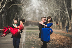 Bridesmaids and groomsmen of wedding couple posing in park Stock Images