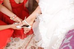 Bridesmaids Helping Bride Royalty Free Stock Photos