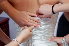 Bridesmaids Helping With Dress Royalty Free Stock Photo