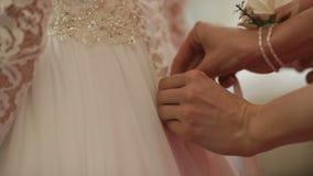Bridesmaids helps up wedding dress. wedding day stock footage