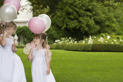 Bridesmaids Holding Balloons In Garden Royalty Free Stock Photography
