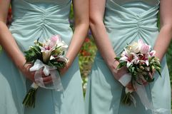 Bridesmaids holding bouquets royalty free stock photos