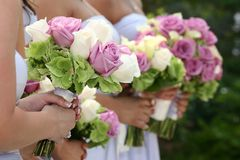 Bridesmaids holding bouquets Royalty Free Stock Images