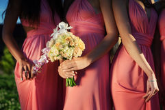 Bridesmaids holding Bouquets of orchids. Royalty Free Stock Photos