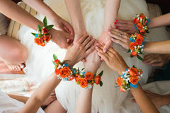 Bridesmaids holding bride's hands Royalty Free Stock Photo