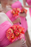 Bridesmaids holding flowers. Bodies of young bridesmaids holding bouquets of flowers at wedding Royalty Free Stock Photography