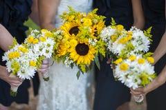 Bridesmaids holding flowers Stock Photos