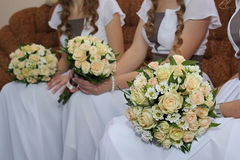 Bridesmaids holding wedding bouquets Stock Images