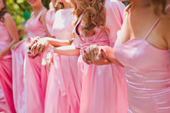 Bridesmaids. Are kept in hand closeup royalty free stock photo