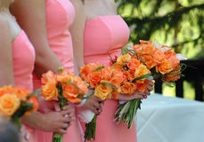 Bridesmaids in a row stock images