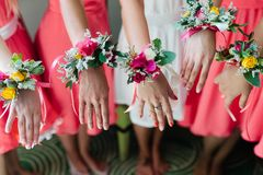 Bridesmaids. In with wedding bouquet hand stock photo