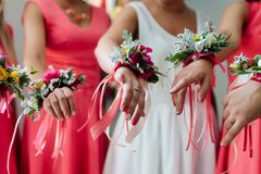Bridesmaids. In with wedding bouquet hand royalty free stock photography