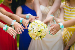 Bridesmaids and wedding bouquet Royalty Free Stock Images