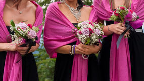 Bridesmaids with wedding bouquet Stock Photography