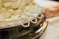 Bridesmaids Wedding Cake Pulls. Made with pearls that sits on top of a silver cake plate Royalty Free Stock Photography