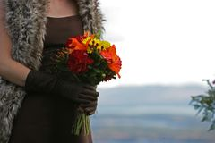 Bridesmate holding a beautiful flower bouquet royalty free stock photos