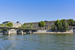 "Bridge ""Pont des Arts"" and museum Louvre Royalty Free Stock Photos"